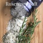 Rosemary salt in a jar with fresh rosemary sprigs