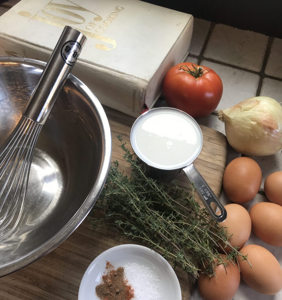 mixing bowl, whisk and eggs