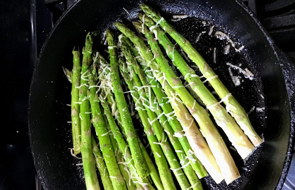 asparagus in a cast iron pan