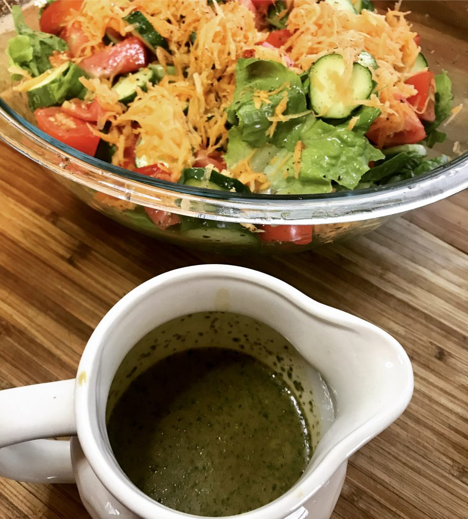 Salad with vinaigrette dressing on the side